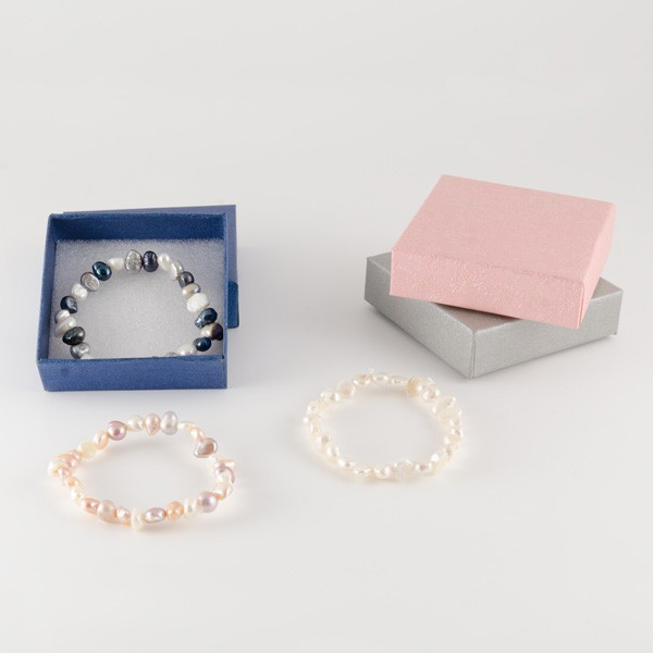 Detalle comunión pulsera perlas naturales